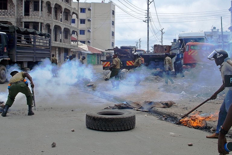 <p>Kenyan police fire tear gas during riots sparked by the killing of a Muslim cleric in the port city of Mombasa on October 4, 2013. Rioters set fire to a church in Mombasa, in furious battles with the police sparked by the killing of Sheikh Ibrahim Ismail, police said.</p>