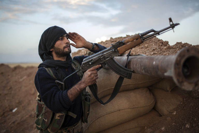 <p>A fighter of the Kurdish YPG. Kurdish fighters are engaged in combat against Al Qaeda-affiliated groups, the Islamic State of Iraq and the Levant and Al-Nusra Front, said the Syrian Observatory for Human Rights.</p>