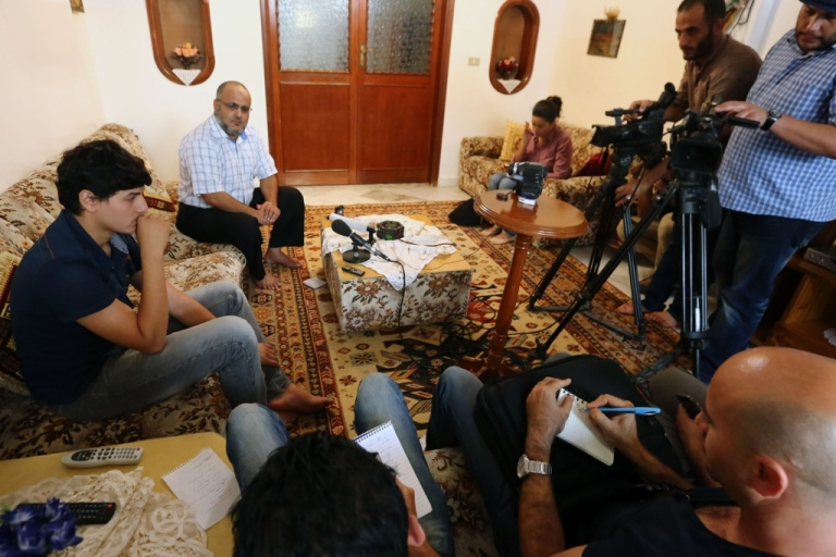 <p>Abdul Moheman al-Raghie (L) and Nabih al-Raghie, the son and brother, respectively, of Al Qaeda suspect Abu Anas al-Liby, speak to the press in Nofleine, five kilometers from the Libyan capital Tripoli on Oct. 6, 2013. Al-Raghie said he does not trust the Libyan government, which he believes is implicated in his father's capture on Oct. 5, but Libyan authorities insist they were unaware of the special forces operation that captured Liby.</p>