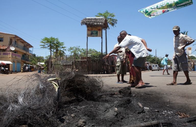 <p>Men point to the spot in the center of Hell-Ville, on Nosy-Be island, where a furious mob lynched on Oct. 3, 2013 two Europeans and a local man suspected of killing a boy for his organs.</p>