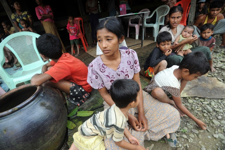 <p>Muslim residents take shelter at a house in Thabyu Chai village near Thandwe, in Myanmar's western Rakhine state on October 2, 2013. Terrified women and children hid in forests and security forces patrolled tense villages in western Myanmar as police said the toll from fresh anti-Muslim unrest rose to five.</p>