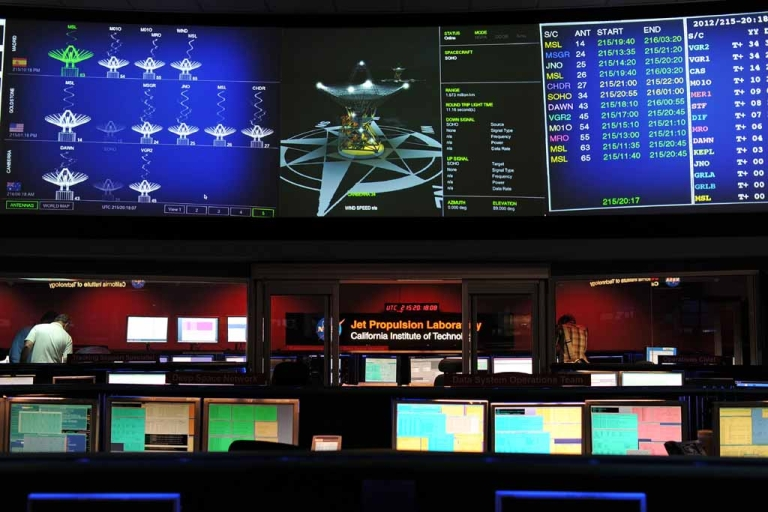 <p>NASA's Mars Science Laboratory mission members work in the data processing room beside Mission Control at the Jet Propulsion Laboratory in Pasadena, Calif., on August 2, 2012, ahead of the landing of the Mars rover Curiosity.</p>