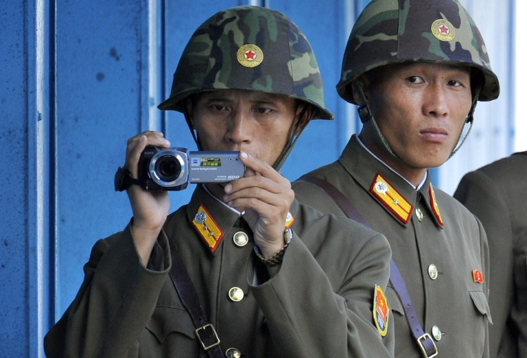 <p>North Korean soldiers film across the demilitarized zone separating the two Koreas. Some South Korean politicians are accused of conspiring with the North.</p>