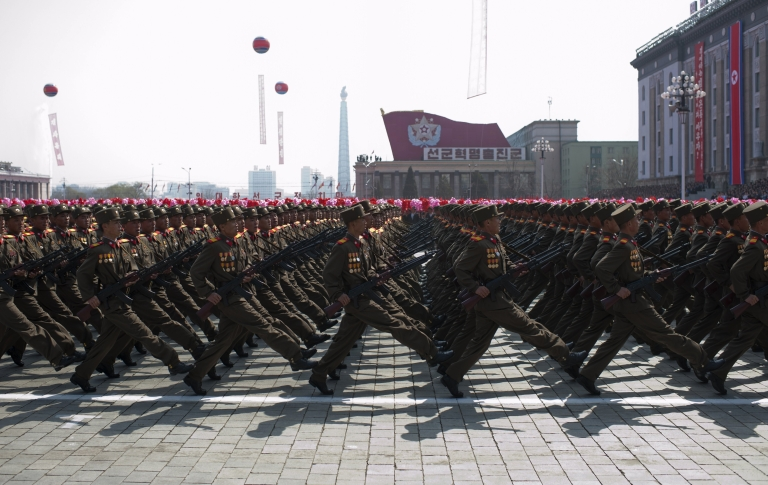 <p>North Korean soldiers march in a military parade, in April 2012.</p>