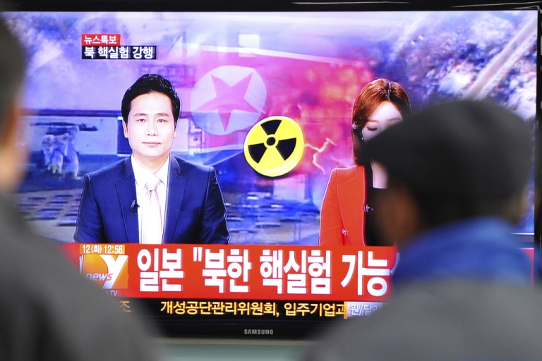<p>South Koreans watch TV news reports of North Korea's apparent nuclear test, Feb. 12, 2013.</p>