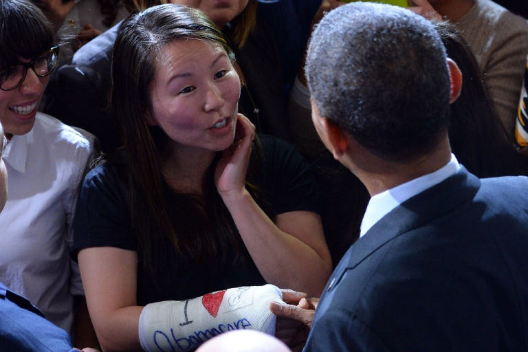 <p>Cathey Park speaks to President Barack Obama, who autographed her cast which reads