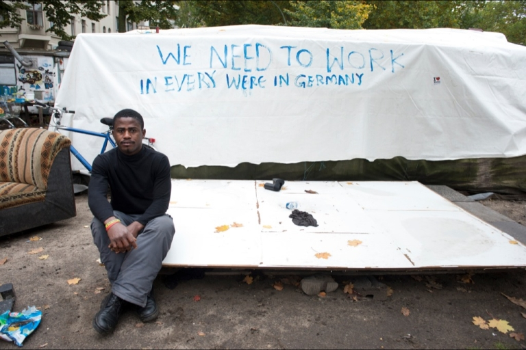 <p>Ghanaian refugee Johnson Takyi poses at an improvised refugee camp in Berlin's Oranienplatz on Oct. 16. Takyi, who fled Libya's civil war by ship to the Italian island of Lampedusa, fears his brother was one of the hundreds of victims of this month's Lampedusa shipwreck.</p>