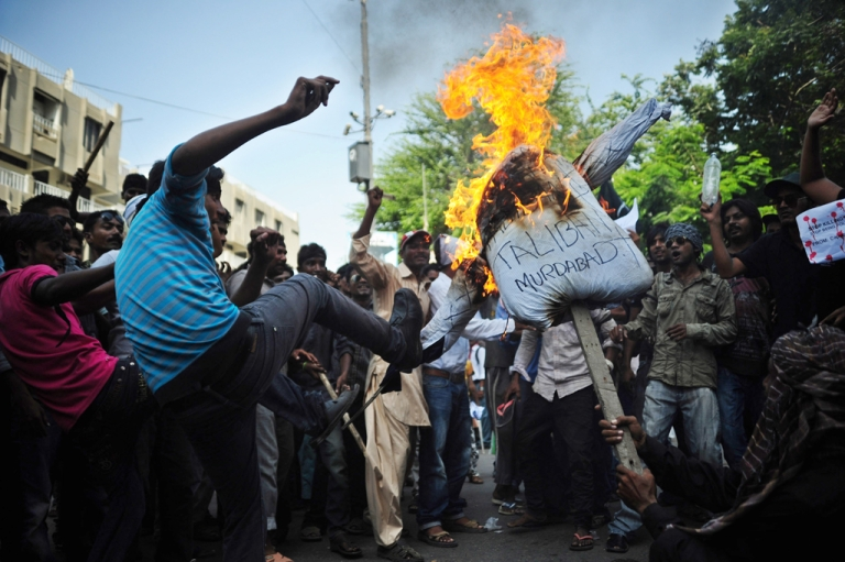 <p>Pakistani Christians burn an effigy of the Taliban during a protest in Karachi on Sept. 23, 2013, in reaction to bomb attacks at a church in Peshawar.</p>