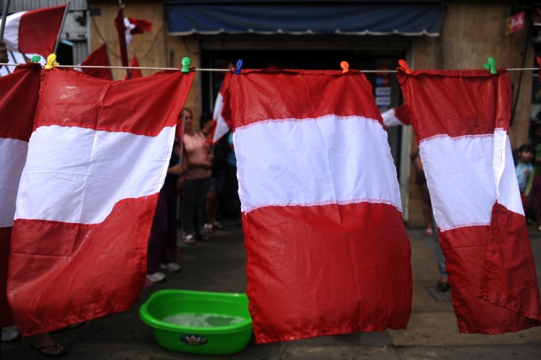 <p>Peru's flag hangs out to dry. But can Peruvians ever scrub the country of its dirty business?</p>