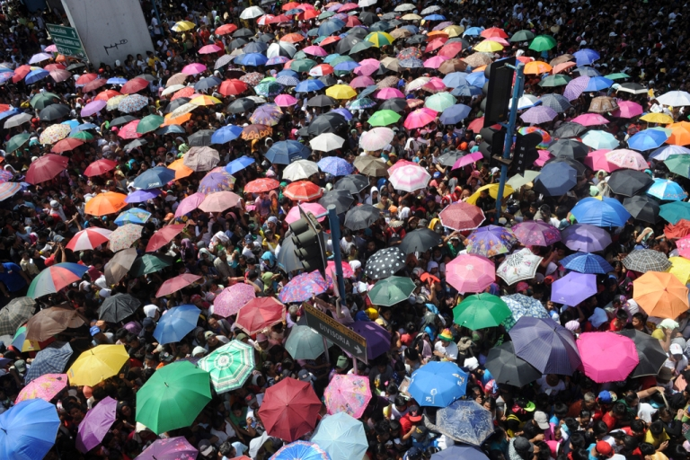 <p>Thousands of people line up for charity packages being given Iglesia ni Cristo (Church of Christ) in Manila as they hold a massive evangelical event in five areas in the city that attracted over a million people and brought Manila to a standstill with gigantic traffic jams.</p>