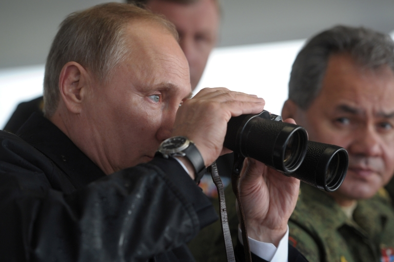 <p>Pursuing his personal vision: Putin at joint military exercises of Russian and Belarus troops last month.</p>
