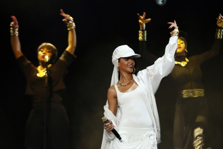 <p>Barbadian singer Rihanna performs on stage during a concert on October 19, 2013 in Abu Dhabi.</p>