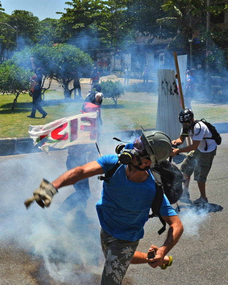 <p>Activists clash with security forces in front of the hotel where Brazil's National Petroleum Agency (ANP) will auction drilling rights to one of the world's largest offshore oil discoveries, in Barra de Tijuca, Rio de Janeiro, Brazil on October 21, 2013. Bidding on the coveted Libra oil field - which contains an estimated eight to 12 billion barrels of recoverable crude - opens Monday with 11 firms vying for a share of production.</p>
