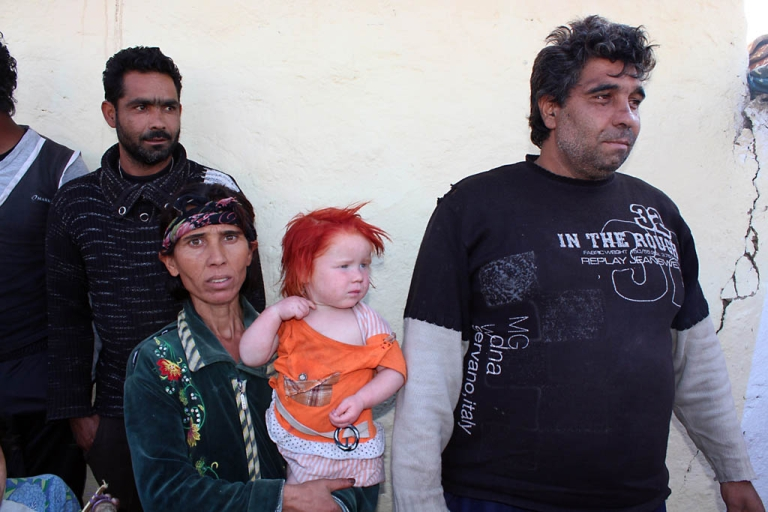 <p>Sasha Ruseva holds one of her nine children next to her husband and Atanas Rusev in Nikolaevo, Bulgaria on Oct. 24, 2013. A DNA test confirmed the couple is the biological parents of Maria, the blonde girl found in a Greek Roma camp last week.</p>