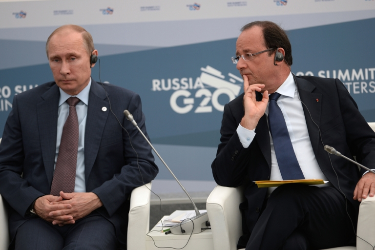 <p>President of the French Republic Francois Hollande, (R) and President of the Russian Federation Vladimir Putin attend a meeting during the G20 summit on September 6, 2013 in St. Petersburg, Russia.</p>