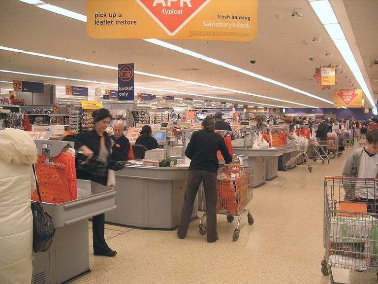 <p>The checkout line at a UK Sainsbury's grocery store.</p>