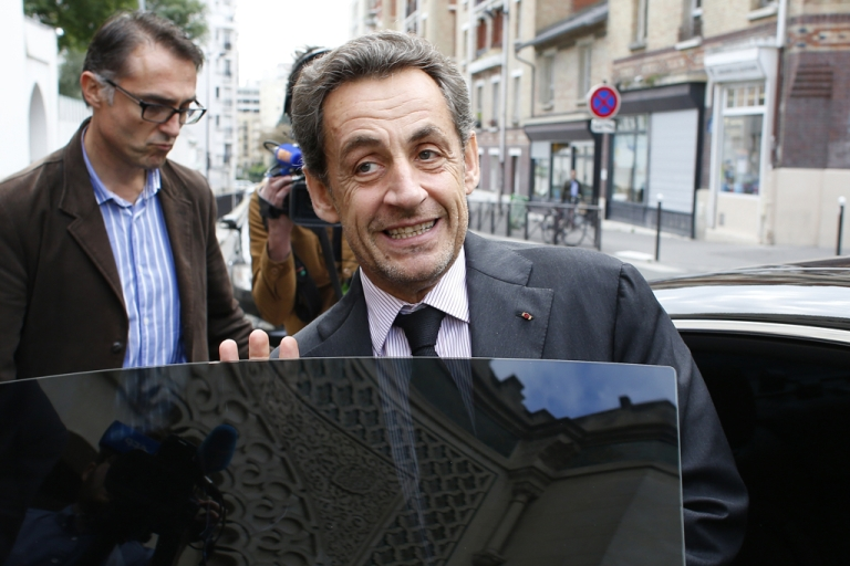 <p>Former French President Nicolas Sarkozy leaves on October 7, 2013 Paris' Great Mosque after attending a lunch with the rector. Corruption charges against former French president Nicolas Sarkozy linked to the financing of his successful 2007 election campaign have been dropped, judicial sources told AFP on October 7.</p>
