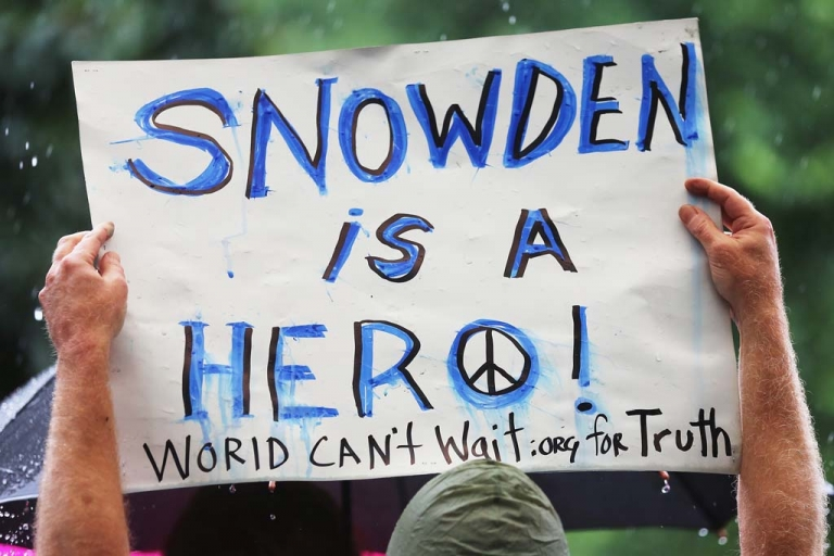 <p>A supporter holds a sign at a small rally in support of National Security Administration (NSA) whistleblower Edward Snowden in Manhattan's Union Square on June 10, 2013 in New York City. Spying revelations via documents released by Snowden have caused serious tensions between European countries and the US.</p>