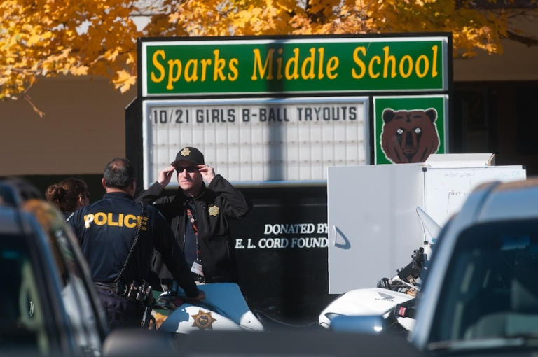 <p>SPARKS, NV - OCTOBER 21:  Law enforcement gather in the parking lot after a shooting at Sparks Middle School October 21, 2013 in Sparks, Nevada. A staff member was killed and two students were injured after a student opened fire at the Nevada middle school. The suspected gunman was also killed.</p>