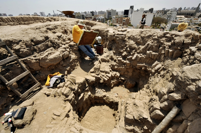 <p>Archaeologists work at the pre-Inca religious complex