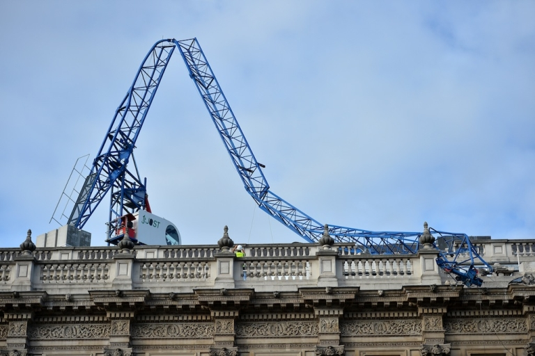 <p>A construction crane lays on top of the cabinet office government building after collapsing in high winds during a storm in central London on Oct. 28, 2013.</p>