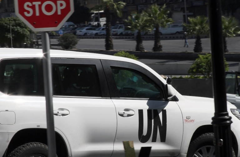 <p>A United Nations vehicle carrying weapons inspectors leaves a hotel in Damascus on Oct. 11, 2013.</p>