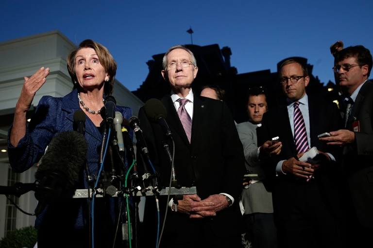 <p>US House Minority Leader Rep. Nancy Pelosi (D-CA) (L) and US Senate Majority Leader Sen. Harry Reid (D-NV) (R) speak to the media with after a meeting at the White House with US President Barack Obama, Speaker of the House John Boehner and Senate Minority Leader Mitch McConnell about the government shutdown on October 2, 2013 in Washington, D.C.</p>