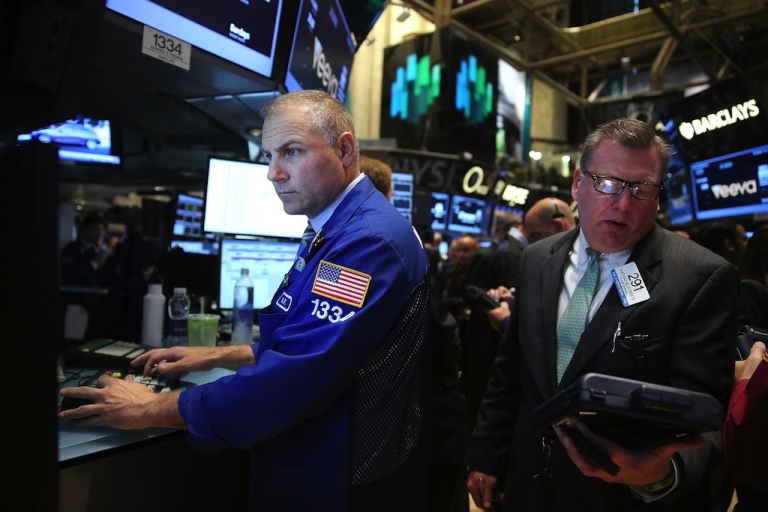 <p>Traders work on the floor of the New York Stock Exchange on Oct. 16, 2013.</p>