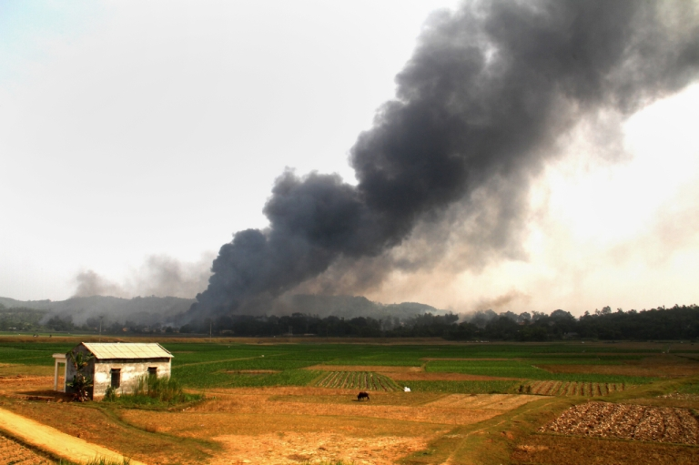 <p>Smoke is seen rising up following an explosion at a firework factory in the northern province of Phu Tho on October 12, 2013. At least seven people died early on October 12 in an explosion at a fireworks factory within a military complex, state media reported.</p>
