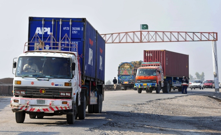 <p>Trucks carrying supplies for NATO forces in Afghanistan return from Pakistan's Torkham border crossing on Nov. 26, 2011.</p>