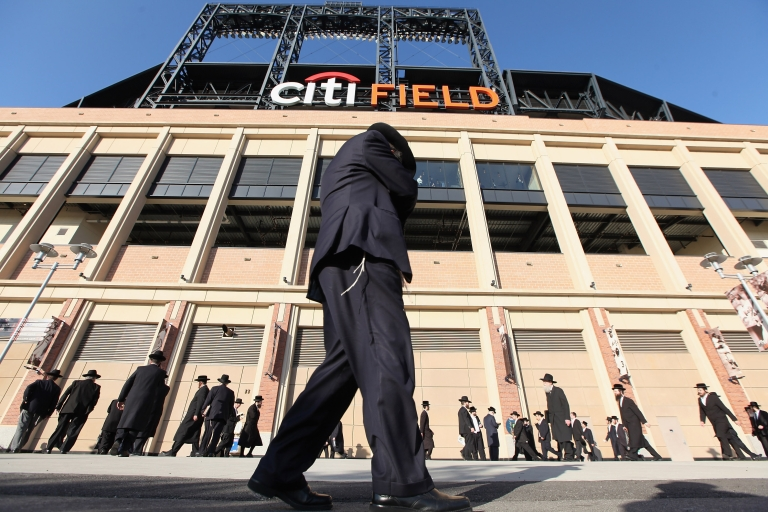 <p>Ultra-Orthodox Jews gather before entering Citi Field for a meeting to discuss the risks of using the Internet on May 20, 2012 in the Queens borough of New York City. More than 40,000 were expected to attend the rally at Citi Field, the home of the New York Mets, which organizers said would promote religiously responsible ways to use the Internet.</p>