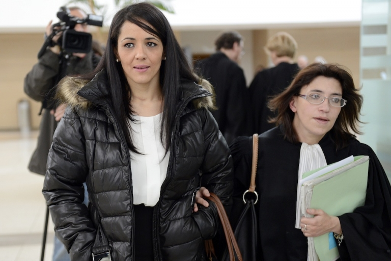 <p>Bouchra Bagour, the mother of a three-year-old boy named Jihad who was born Sept. 11, leaves court in Avignon, France in December 2012. She faced charges after sending him to school in a T-shirt that said