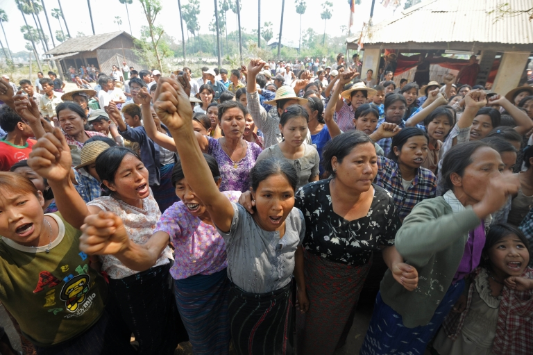 <p>Villagers shout slogans as they protest against Myanmar opposition leader Aung San Suu Kyi's stand on a Chinese-backed copper mine project, in Monywa northern Myanmar on March 14, 2013. Suu Kyi urged protesters to accept a controversial Chinese-backed mine that was the scene of a violent crackdown last year, or risk hurting the economy.</p>