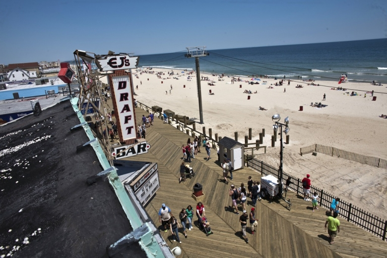 <p>People walk by the boardwalk at Seaside Heights on the first weekend of Jersey Shore beaches re-opening to the public on May 27, 2013 in Seaside Heights, NJ.</p>