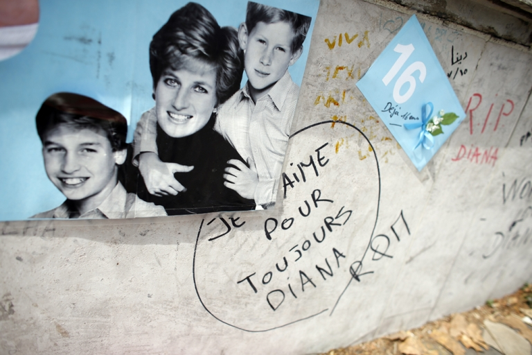 <p>A photo showing the late Princess Diana and her sons, Prince William and Prince Harry, sits on Pont de l'Alma in Paris on August 31, 2013, the 16th anniversary of the car crash that killed Diana.</p>