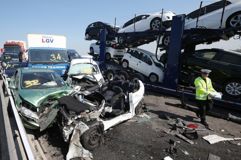 <p>Emergency Services attend the site of a major traffic accident on the A249 Sheppey crossing bridge in Kent on September 5, 2013 in Isle of Sheppey, Kent. Over 130 vehicles were involved in the series of accidents, with thick fog blamed for poor visibility. The crash occurred around 7:15 am with at least 8 people suffering serious injuries, and approximately 60 people treated for minor injuries.</p>