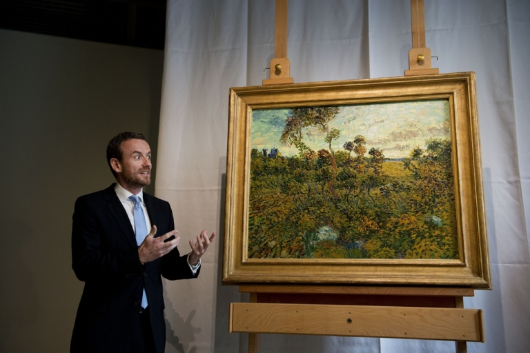 <p>Alex Ruger, director of the Van Gogh Museum in Amsterdam, unveils a painting by Vincent van Gogh, entitled 'Sunset at Montmajour' and painted in 1888, on September 9, 2013. It had been lying for years in the attic of a Norwegian collector who thought the picture was a fraud.</p>