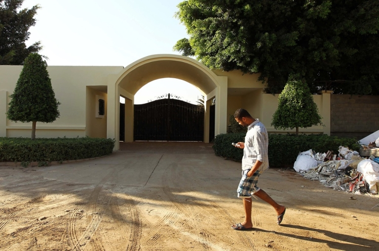<p>A Libyan man walks by the main entrance of the US consulate in Benghazi on September 10, 2013 on the eve of the anniversary of the 2012 attack on the diplomatic mission that left four people dead.</p>