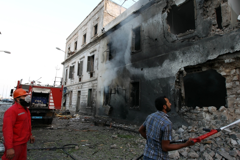 <p>Libyan firefighters extinguish a fire caused by a powerful blast near a foreign ministry building on September 11, 2013 in the eastern Libyan city of Benghazi. The explosion comes on the first anniversary of an attack by militants on the United States consulate in Benghazi, which killed four Americans, including the ambassador.</p>