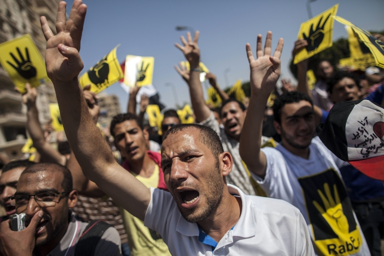 <p>Supporters of ousted Egyptian president Mohamed Morsi raise up posters with the four finger symbol during a demonstration against the military backed government in the Egyptian capital Cairo, on September 13, 2013. Thousands of Morsi supporters rallied in Cairo after Friday prayers chanting angry slogans against the military, with clashes reported elsewhere in Egypt. The four finger symbol, known as 'Rabaa', meaning four in Arabic, is used to remember those killed in the crackdown on the Rabaa al-Adawiya protest camp in Cairo in July.</p>