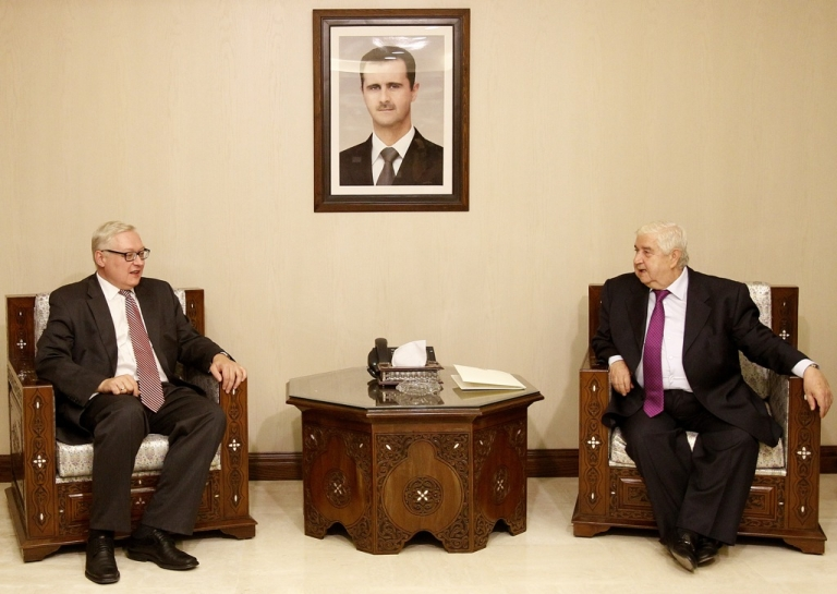 <p>Syrian Foreign Minister Walid Muallem (R) meets with Russian Deputy Foreign Minister Sergei Ryabkov (L) in Damascus on September 17, 2013. Ryabkov claims that Syria's government has passed on new evidence that rebels, not the army, carried out chemical weapons attacks.</p>
