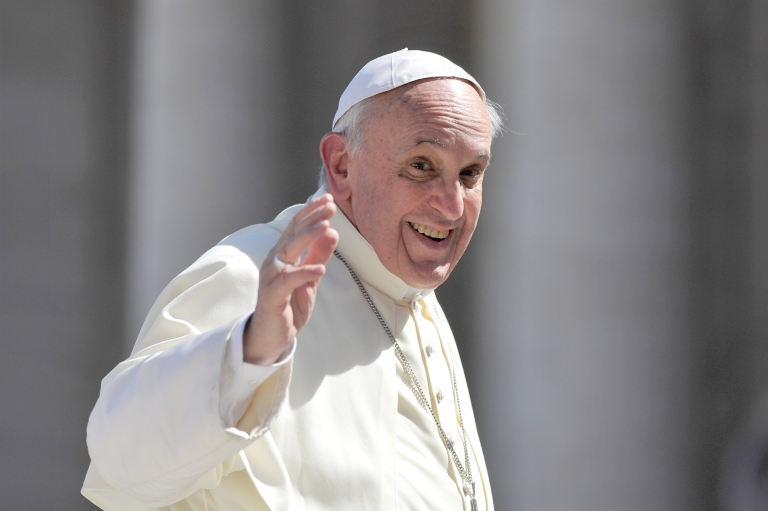 <p>Pope Francis waves after his general audience in St Peter's square at the Vatican on September 18, 2013.</p>