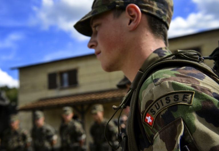 <p>An aspirant-officier of the Swiss Army rescue troops takes part in a training session on September 19, 2013, in Epeisse near Geneva.</p>
