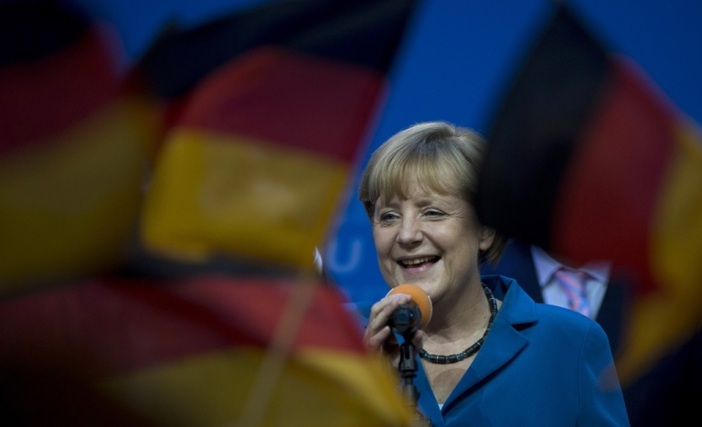 <p>Angela Merkel celebrates at the Christian Democratic Union (CDU) party's headquarters in Berlin on September 22, 2013, after winning her third term as German chancellor.</p>