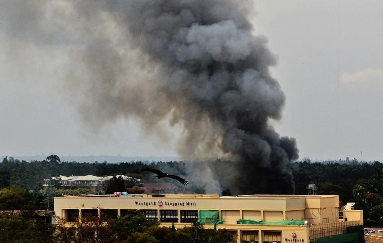 <p>Smoke rises from the Westgate mall in Nairobi on September 23, 2013. Kenyan troops were locked in a fierce firefight with Somali militants inside the complex in a final push to end a siege that has left at least 62 dead and 200 wounded with an unknown number of hostages still being held.</p>