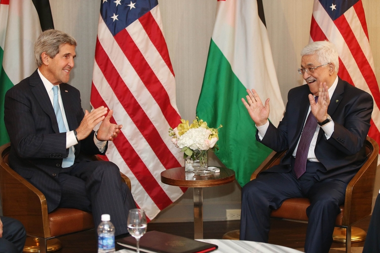 <p>U.S. Secretary of State John Kerry (L) gestures at the start of a bilateral meeting with Palestinian Authority President Mahmoud Abbas on September 24, 2013 in New York City. Diplomats from around the world have descended on New York for the annual United Nations General Assembly.</p>