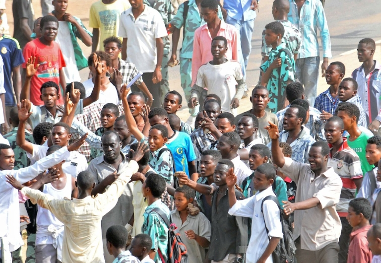 <p>Sudanese protestors demonstrate in Khartoum's twin city of Omdurman after the government announced steep price rises for petroleum products after suspending state subsidies as part of crucial economic reforms on September 25, 2013.</p>