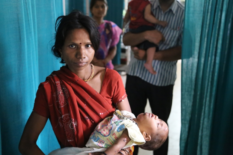 <p>A mother with her 3-year-old daughter who suffers from chronic diarrhea and tuberculosis, at the District Hospital, Panna, Madhya Pradesh in Central India.</p>
