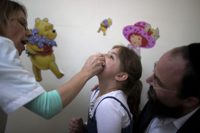 <p>An Israeli child receives a vaccination against Polio at a clinic in Jerusalem on August 18, 2013. Israel took its polio vaccination campaign nationwide.</p>