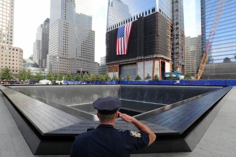 <p>York City Police Officer Danny Shea salutes at the North pool of the 9/11 Memorial on Sept. 11, 2011 in New York City.</p>